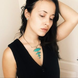 Kendra Scott turquoise necklace.